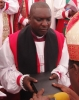 Bishop Paul Masaba Receiving Bible