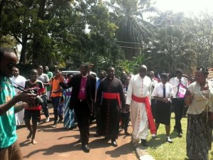Supporters formed a spontaneous procession from St. Paul's Cathedral, Namirembe, to the Archbishop's Residence