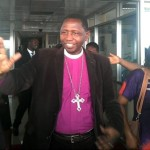 Archbishop Stanley Ntagali greeting people at Entebbe Airport