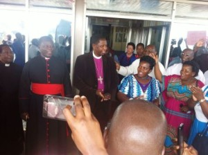 Archbishop Stanley speaking to supporters outside the Entebbe Airport