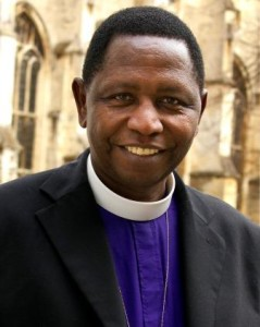 The Most Rev. Stanley Ntagali in front of Canterbury Cathedral