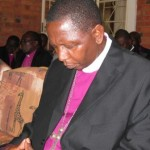 Abp Stanley praying 1